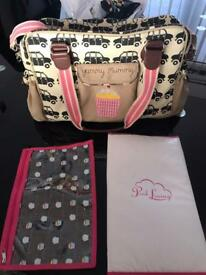 Pink lining yummy mummy black cab baby changing bag