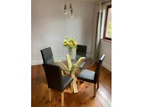 Round glass dining table and 4 faux leather chairs