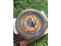 Spare truck/trailer rim and tyre.