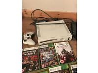 Xbox 360 console and controller with 25 games and band hero