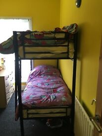 Black metal bunk beds , 10 months old with mattresses