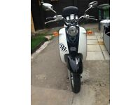 Black and white BTM 50cc Moped
