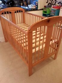 Wooden cot/ children's bed. Cot has drop side and three base heights
