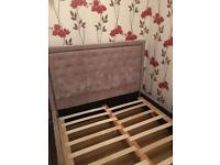 Double bed frame with mattress.