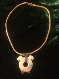 Rolled gold chain with jade butterfly