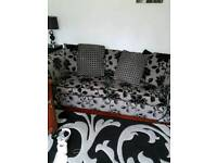 Gray and black 3 seater sofa bed