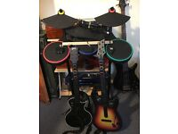 PlayStation 3 Guitar Hero Bundle: Drums, Microphone, 2 Guitars, Sticks, Dongles and 5 Games for PS3