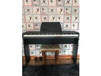 A Roland ep-760 electric piano with stand, stool, foot pedal and power supply. Fantastic condition