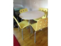 Retro style table and Ikea chairs