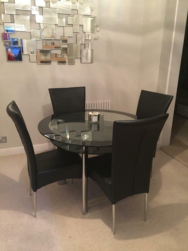 Black Glass Circular Dining Table From Harveys With 4 Leather Chairs