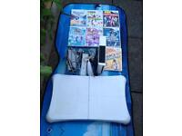 Nintendo Wii console Wii board and games