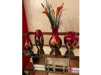 4 matching red vases