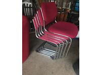 Stack of office chairs for sale!