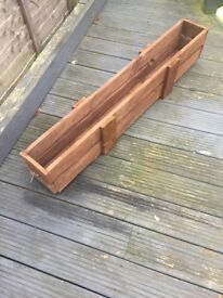 Thin Wooden planter for the garden