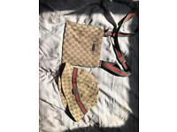 Gucci bucket hat and Gucci messenger bag