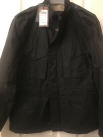 Men's olive wax Barbour jacket in small still with tags from Fenwicks!