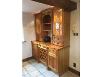Kitchen dresser unit with cupboards,drawers,glass cabinets,lighting and wine rack