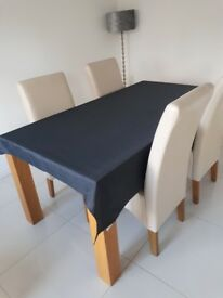 Oak table and 4 cream faux leather chairs