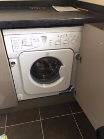 Brand New Integrated Indesit Washing Machine, 11 months warranty remaining.
