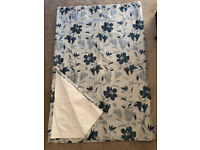Pair of lined beige/navy flowered curtains (ringlet top)