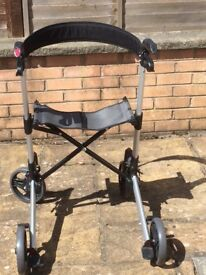 Walker aid-good condition with 4 wheels & seat