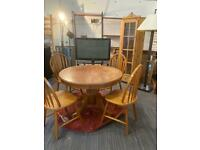 Pine circular dining room table and four chairs