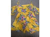 Woman's yellow floral play suit