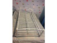 White metal toddler bed