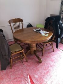 Oak round extending table /chairs