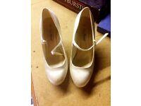 White Anne Michaels bridal shoes