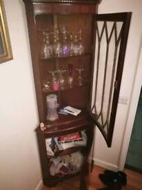 2 brown corner cabinets