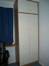 Wardrobe with bottom drawers