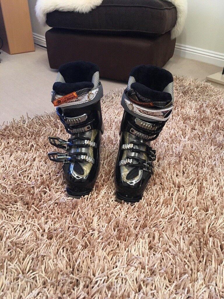 Solomon Ski Boots and helmet