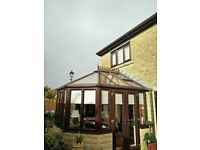 Glass conservatory roof with brown PVC surround