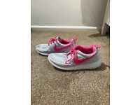 Silver and pink women's Nike trainers