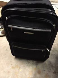2x suitcases. Wheels and pull must sell