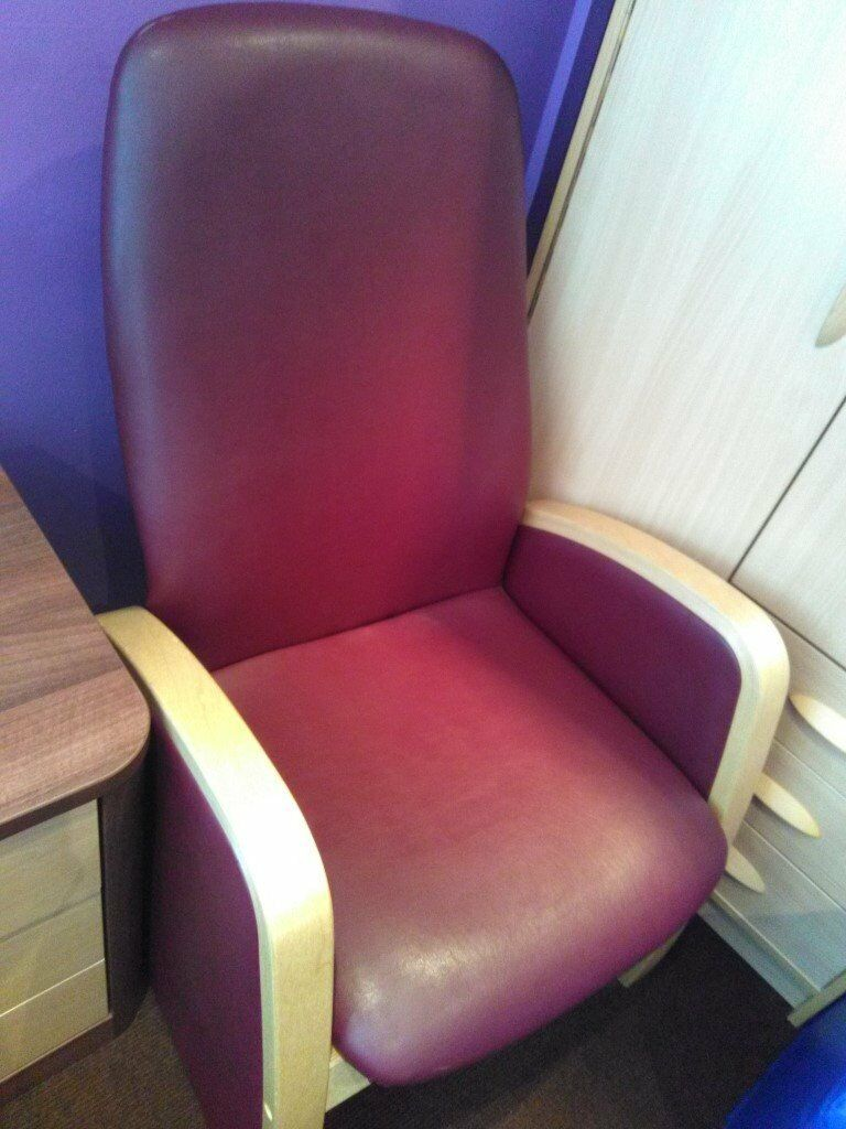 High backed wooden armed armchair in burgundy vinyl. Excellent condition.