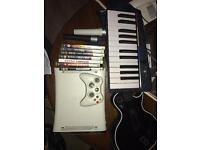Xbox 360, controller, keyboard, guitar & 2 mics, 7 games