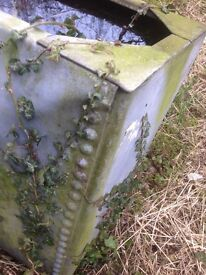 Antique rivetted galvanised water tank