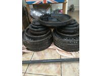 247.5kg cast iron olympic plates and 20kg bar