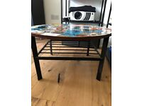 Sturdy table - brown wood and black metal. Round, alternative, stickers.
