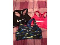 3x girls Nike gym tops