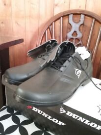 Brand new, Size 12 mens Dunlop Golf Shoes. Black