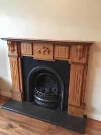 Oak fireplace with hearth and cast iron inset