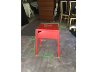 Red metal bedside table