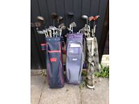 Golf clubs, 28 in total, plus 3 bags