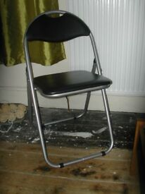 Folding silver/black padded chair