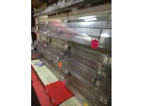 9 drop tiered Perspex magazine shop retail shelving.