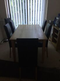 Contemporary Light Oak Wood Table and 6 Chocolate Brown Faux Leather Chairs