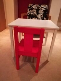 Child's Red chair and table and 3 plastic chairs